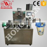 Hongzhan KIS900 automatic plastic cup or box rotary type cup filling and sealing machine
