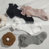 Children's Spain autumn and winter new big bow girl baby socks solid color mid-high long tube socks