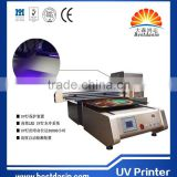 Design vinyl stickers machine for any brand mobile phone case UV printer 0609 model 60cmX90cm with DX5 printhead