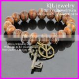 KJL-BD5221 Hot Selling Tibetan Matte Agate Oneline round beads Bracelet with Antique key Stretch bracelet