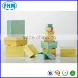 square yellow gift box tower