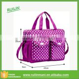plum purple white dot pattern large changing bag with baby urine pad and bottle sleeve