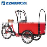Family carring colorful cargo bike