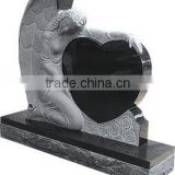 angel with heart carved headstone