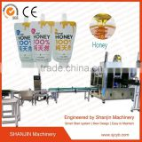 automatic spout pouch capping machine/water sachet packing machine/water pouch packing machine price