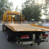 small flatbed towing truck