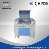1390 jinan donglian laser engraving and cutting machine second hand have in stock for glass cup