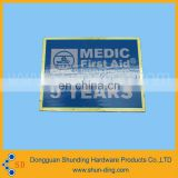 square blue background badge meid