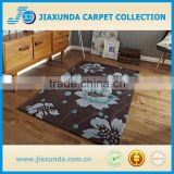 Brown/blue hand carved acrylic a bold floral pattern and stems in natural brown rug for living room