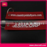 customized remove before flight spinning keychain