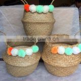 High quality best selling eco-friendly Natural seagrass baskets with colored pompoms from Vietnam