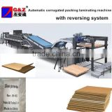 Automatic corrugated packing laminating machine with reversing system