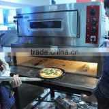 Stainless steel round shaped pizza peel in baking equipment
