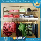 sundry clothing store tension fabric racks and displays stand shelves for textiles