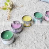 Multi-colored scented tin candles with metal lid