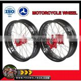 "Motorcycle wheels: CRF Supermoto wheelsets: Red hubs with black rims 3.50-17"" and 5.00-17"""