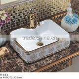 KJ3124 Water mark high quality gold color counter top china wash hand basin