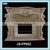 natural stone interior fireplace surround with lady sculpture