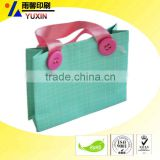 FOLDABLE SHOPPING PAPER BAG / RIBBON HANDLE PAPER BAG / LIGHT BLUE GIFT PACKAGING BAG / WHOLESALE SHENZHEN YUXIN GIFT PACKAGE