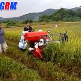 Cheapest price mini rice combine harvester / rice reaper working in muddy field