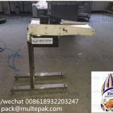 multepak manual poultry bagging machine loader with clipper