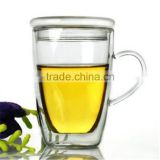 Hand made product- Heat resistant Double wall borosilicate glass cup with clear handle and lid.