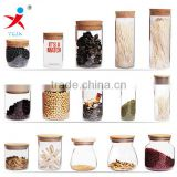 Different Volumes Glass Jars With Wood or bamboo covering