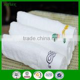 GaoYang towel factory100% cotton dobbby white hotel towel embroidery logo hotel gift face towel