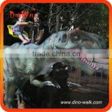 Amusement park outdoor kid riding dinosaur, realistic robot riding dinosaur