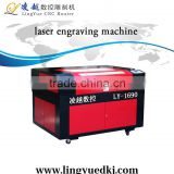 jinan hot selling!!!laser engraving machine 1690/cnc laser cutting machine price/can customered!