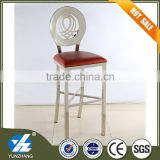 round back high chair with red soft seat