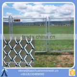 chain link fence/ fence post/ wrought iron fence