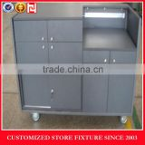 Grey cash wrap counter with castors
