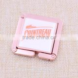 Hot sale square rose gold bag purse hanger/ foldable bag purse holder with epoxy sticker logo