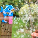 Battery operated blowing dolphin shaped bubble gun toy
