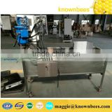 bee uncapping honey tank in bulk honey uncapping tray