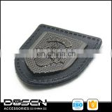 Wholesale factory direct custom metal badge plate on the black leather badge for garment accessories.