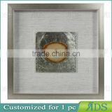 Box photo frames with mottled silver background encasing natural agate under glass