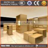 Supply all kinds of display risers,wheel rim display rack,attractive clothing shop vitrine display
