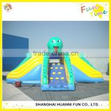 Newly design gaint Customized PVC 0.55mm adults inflatable water slide with climbing wall price