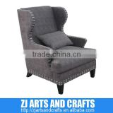 0476 arm sofa (Champagne faux velvet covered arm chair with clear glass diamond buttoned back, piping and dark brown legs.)
