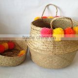High quality best selling eco-friendly Natural seagrass storage basket with yellow & orange pompoms from Vietnam