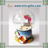 Beach scene glass water globe with polyresin base