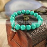 BRH0911 Trendy green dyed jade beaded& goldstone point pendant bracelet