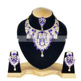 Touch Stone Gold Plated Blue Color Alloy Wedding Collection Necklace Earrings Set & Tikka