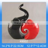 Double ceramic elephant ornament in black and red for home decoration                                                                                                         Supplier's Choice