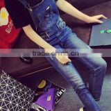 Spring dark blue overalls Siamese Slim influx of female feet hole jeans pants collapse was thin pants suspenders