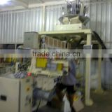 Automatic Carton box Filling & Sealing Machine with multi head weigher