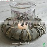 Round decorative candhle holder with wicker wreath and glass and snowflake