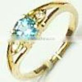 Ring With Blue Topaz & Diamond